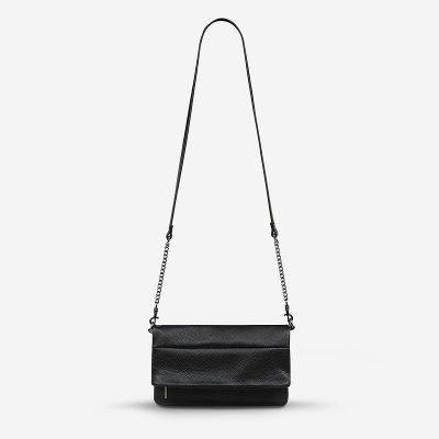 Nest-seven-status-anxiety-bag-unhinged-black-front-hanging-strap.jpg