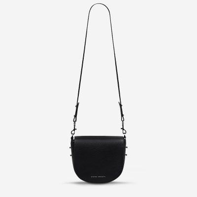 status-anxiety-bag-art-of-pretending-black-front-hanging.jpeg